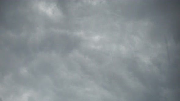 Thumbnail for Real Time Flying Amazing Grey Rain Clouds and Rain Drops Falling Down..