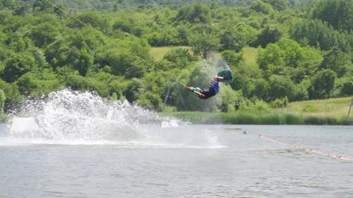Slow Motion View of Extreme Wakeboarder Doing Tricks and Falling in the Water