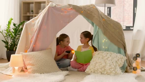 Thumbnail for Happy Girls Reading Book in Kids Tent at Home