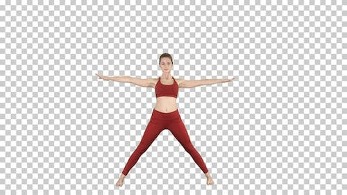 Young woman in forward bending asana yoga pose, Alpha Channel