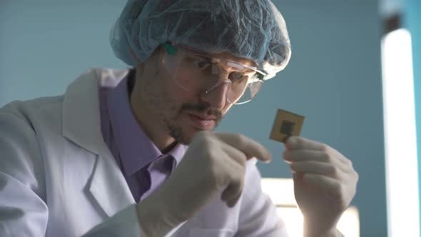 The Engineer Holds a Computer Processor