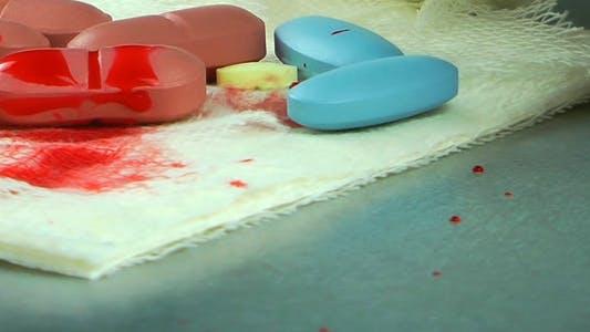 Pills on Gauze Bandage and Blood Drops