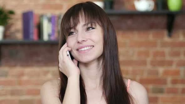 Thumbnail for Beautiful Woman Talking On Smartphone, Indoor