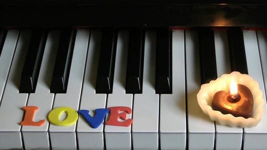 Thumbnail for Love on Piano Keys and Candle Light 3