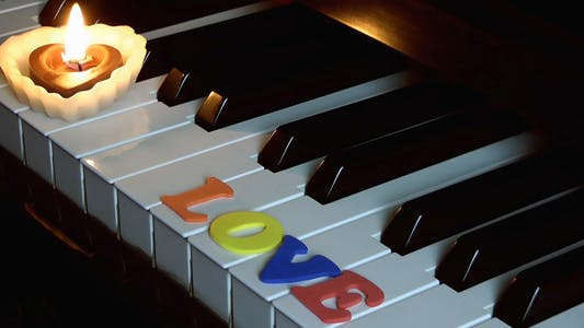 Cover Image for Love on Piano Keys and Candle Light