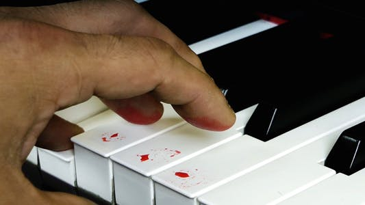 Cover Image for Playing with Blood Fingers on Piano Keys