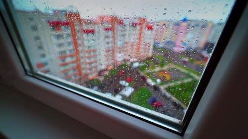 View through the window on raining weather