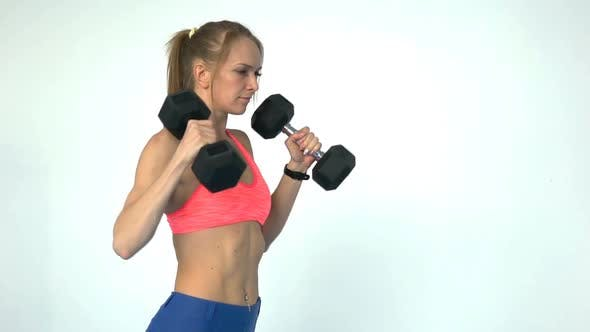 Thumbnail for Fitness Woman Doing Exercise With Dumbbells In The Gym
