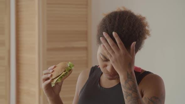 Woman Choosing Between Fast Food and Slimming
