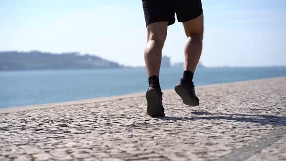 Thumbnail for Mature Man in Shorts and Sneakers Running at Riverside