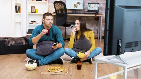 Thumbnail for Couple Sitting on the Floor Watching Tv