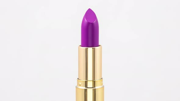 Thumbnail for Close Up Video of Purple Lipstick Rotating in Studio