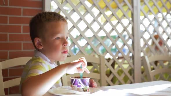 Thumbnail for Kid Eating Chocolate Ice Cream in Summer Cafe