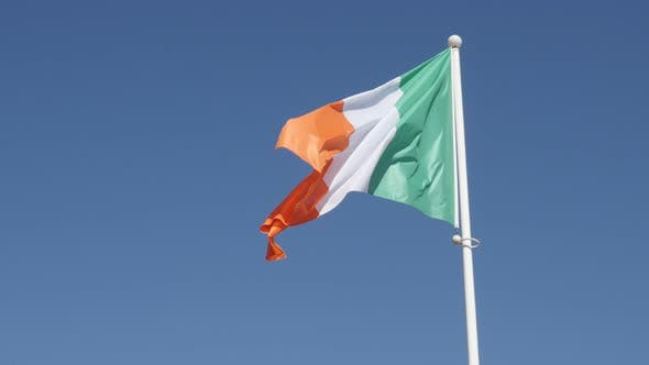 Thumbnail for National symbol of Ireland against blue sky 4K 2160 30fps UHD footage - Irish tricolour flag fabric