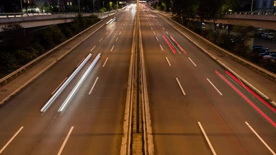 Time lapse of cars driving on a highway at night in 4k