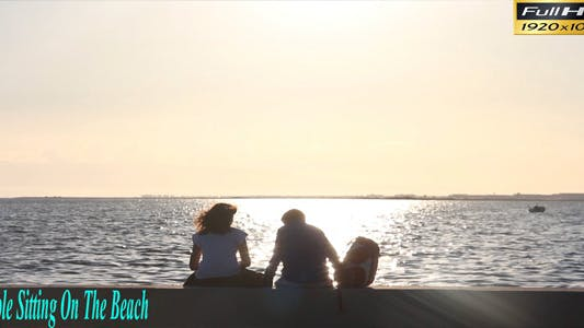 Thumbnail for Couple Sitting On The Beach