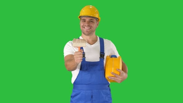 Thumbnail for Worker holding paint brush smiling to camera on a Green