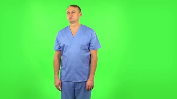 Thumbnail for Medical Man Is Angry, Says Something and Sighs. Green Screen