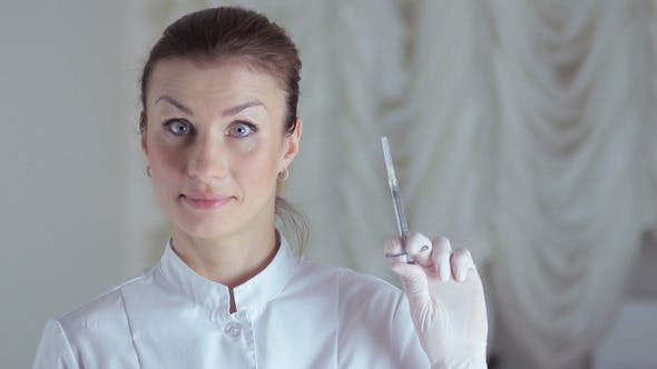 Thumbnail for Woman Doctor Showing Medic Instruments With Humor