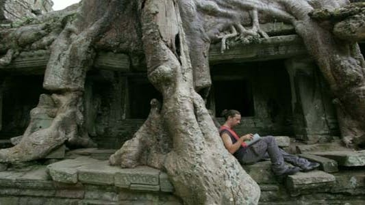Thumbnail for Young Man Reading Book In Angkor