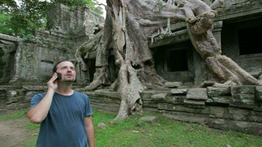 Thumbnail for Man Talking Phone In Angkor