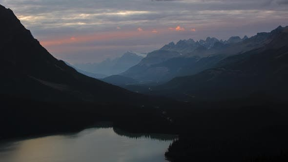 Thumbnail for Sunbeam through mountains at sunset time lapse