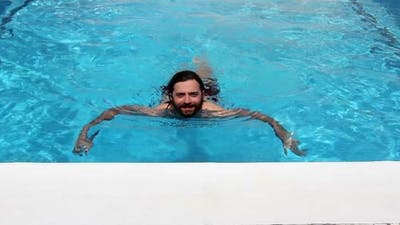 Man Swim In Swimming Pool