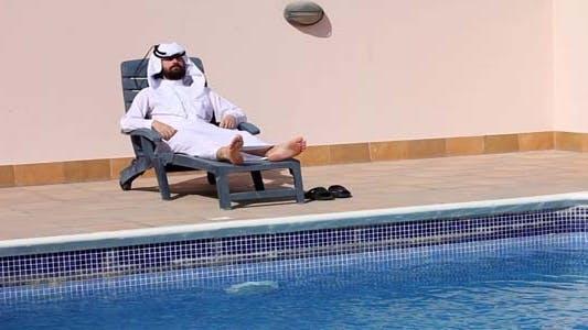 Thumbnail for Saudi Arabian Using Phone At Swimming Pool 2
