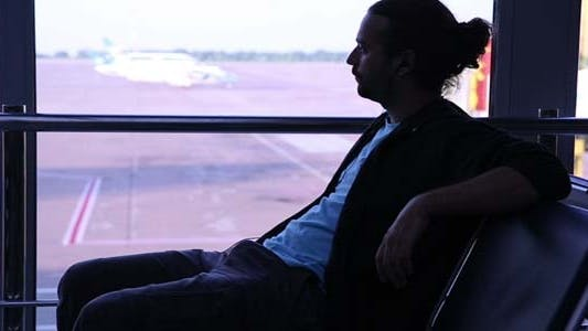 Thumbnail for Young Man Waiting Flight In Airport
