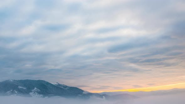 Cover Image for View in Foggy Sunset Winter Mountain