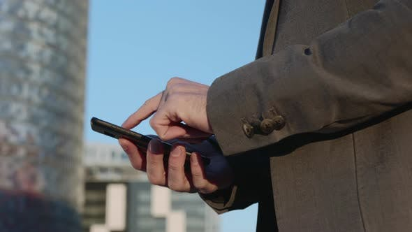 Thumbnail for Businessman Hands Using Smartphone on Street. Employee Typing Message on Phone