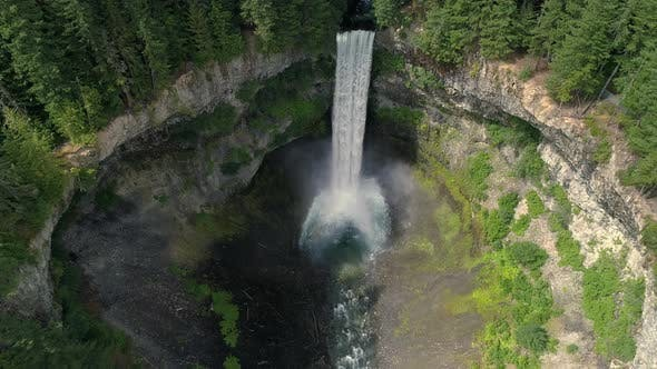 Thumbnail for Aerial Pan Up Large Earth Crater To Epic Waterfall With Green Foliage In Canada