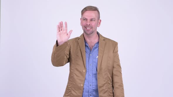 Thumbnail for Happy Blonde Casual Businessman Waving Hand