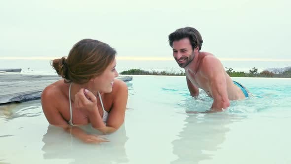 Thumbnail for Couple lying in pool