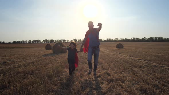 Thumbnail for Father and Son As Superheroes Running Across Field