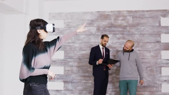Thumbnail for Female Designer with Virtual Reality Goggles in Empty Apartment