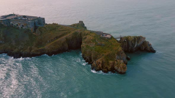 A Flight by a Castle on an Island in the Sea.
