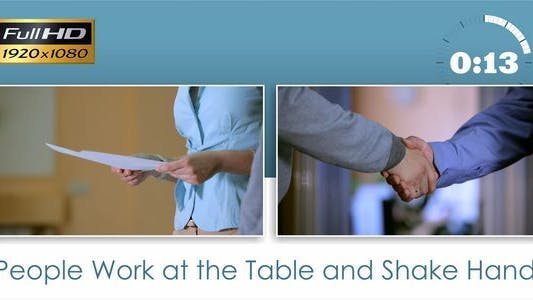 Thumbnail for People Work at the Table and Shake Hands
