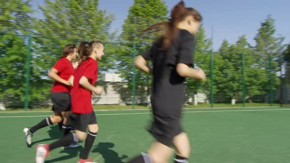 Thumbnail for Female Soccer Players Running on Field during Workout