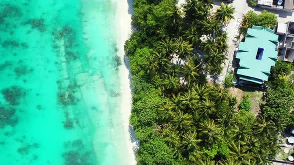 Thumbnail for Natural flying tourism shot of a sandy white paradise beach and aqua blue ocean background in hi res