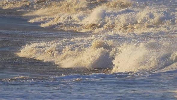 Thumbnail for Waves break in surf line.