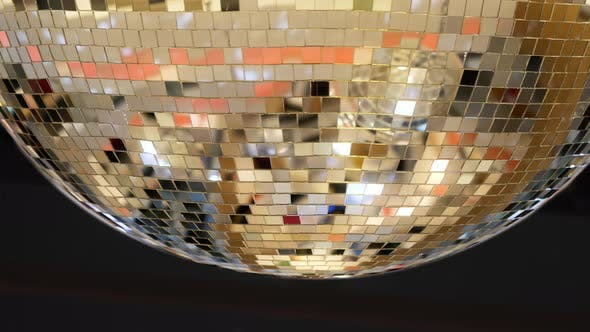 Spinning Sparkling Disco Ball, Mirror Disco Ball Reflecting Yellow Lights, Night Party Concept