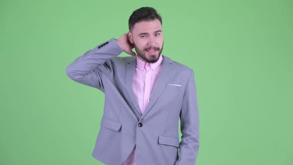 Thumbnail for Confused Young Bearded Businessman Scratching Head