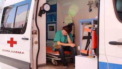 Nurse Thinking In Ambulance