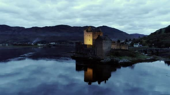 Pan Around of a Castle on Donan Isle and Clouds Reflecting on the Loch