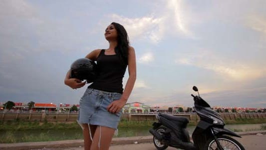 Thumbnail for Sexy Asian Girl With Mini Skirt With Helmet 5