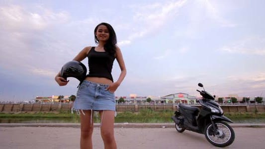 Thumbnail for Sexy Asian Girl With Mini Skirt With Helmet 4