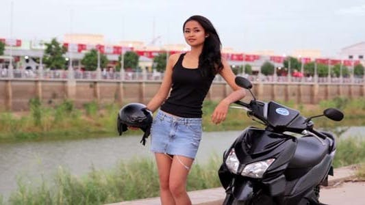 Thumbnail for Sexy Asian Girl With Mini Skirt With Helmet 3