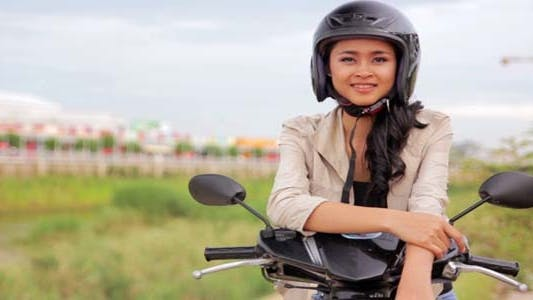 Thumbnail for Sexy Asian Girl With Mini Skirt With Helmet