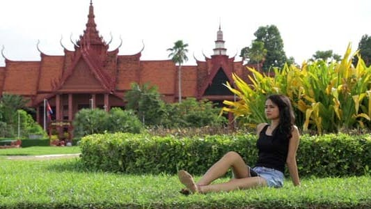 Thumbnail for Attractive Asian Girl On Grass